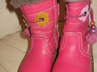 These super cute leather boots are a hot pink color