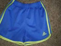 Girls size 5 5t Adidas shorts in purple & lime green.