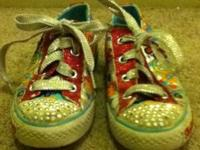 this is a pair of girls skechers sneakers size 12 and