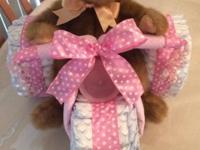 This is a large Brand New Tricycle Diaper Cake Measures