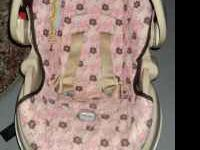 Have for sale a pink and brown infant carrier and base
