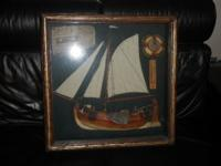 Glass and wood enclosed ship with compass,thermometer