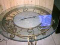 nice clock glass table , very heavy first come first