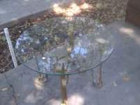 Glass coffee table Solid brass base The glass top and