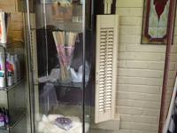Glass curio cabinet with six shelves.  All glass and