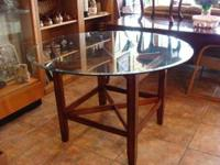 "4'D x 30""H Round Glass Dining Table with Wood Base."