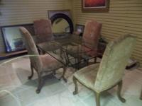 An elegant dining table and 4 upholstered chairs.  The