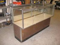 A glass display case that is in good used condition.