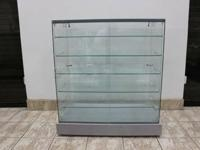 I have 12 frame less glass showcases for sale. They are