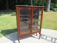 2 door glass front china cabinet. also has glass sides.