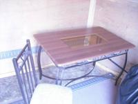 Here is a Kitchen table and 4 chairs in good condition.