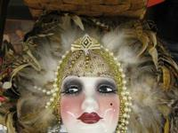 JUST ARRIVED A COOL LOOKING WOMANS FACE WITH FEATHERS