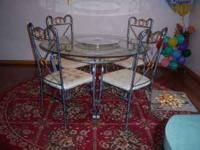 Beautiful glass dining set. Includes 4 chairs and Glass