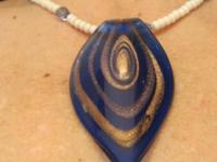 Large blue glass pendant with beautiful gold glitter