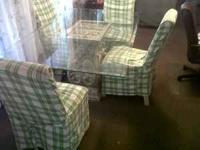 Glass table with 4 chairs. Good shape. it has a little