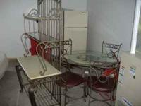 GLASS TABLE AND FOUR CHAIRS ALSO BAKERS RACK. WILL SELL