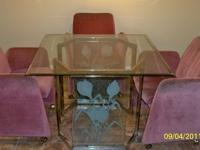 Glass table and fabric arm chairs,. Location: