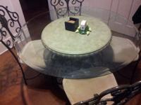 Selling our glass kitchen table. Seats 4. Very nice w/