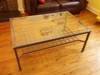Used glass top coffee table. Dark metal with glass