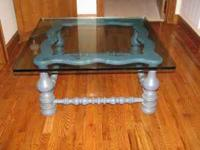 For sale is a beautiful glass top coffee table. Bottom