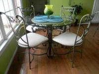 "Glass top table with four chairs and three 29"" bar"