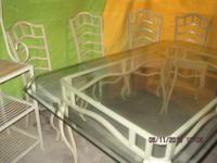 JUST REDUCED! Flawless glass-top dining table measures