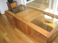 Wooden coffee table with center drawer/cubby (opens