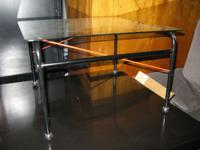 Glass-top End Table $5  This could be used as an end
