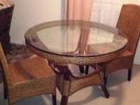 Glass top round table and 2 matching chairs in perfect