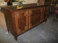 For Sale we have a glass top server with 3 drawers and