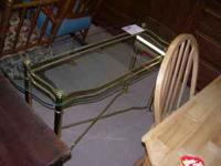 USED GLASS TOP SOFA TABLE. $50. METAL BASE IS BRASS.