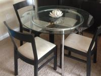"IKEA SALMI round glass top table. Measures 41"" diameter"