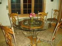 We have a Glass Top Table with 5 chairs for sale. They