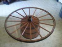 This is a wagon wheel on 1/2 wine barrel I can be