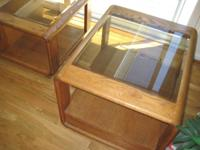 Glass top coffee table, wooden base with shelf.  Best