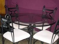 black glass top wrought iron table with 4 chairs