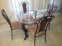 Hello,. I'm offering a glass dining table with 4