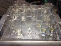 various pieces of glass ware, shot glasses, juice