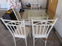 Square Dining room table and 4 chairs suitable for