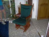 WOOD GLIDER CHAIR W/ GREEN CUSHION IN GREAT CONDITION