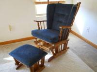 This is a nice dark blue glider rocker with matching