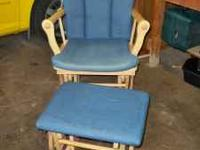 Blue glider rocker with footstool. Solid chair. Please