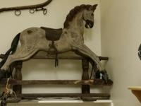 Childs Antique Primitive gliding horse. Not a lot of