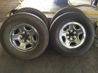 "set of 4 used 16"" wheels and tires of a 1999 gmc sierra"