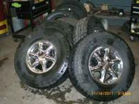 GMC denali wheels with bridgstone dueler a/t tires.