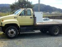 I HAVE A 1997 GMC 5500 FLAT BED TRUCK WITH A 6.1 LITER