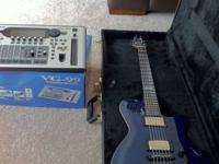 I am selling a Godin LGX-SA in Trans Blue flamed maple