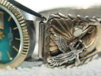 Gold and silver Native American watchband and watch.