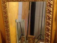 I have for sale a gold framed hanging mirror in great