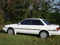 90 Toyota Camry V6 LE White runs like new. Cold A/C put